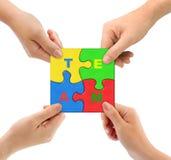 Mãos e equipe do enigma Fotografia de Stock