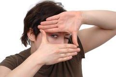 Mãos e olho Fotos de Stock Royalty Free