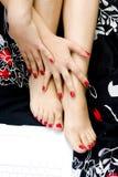 Mãos e pés Imagens de Stock