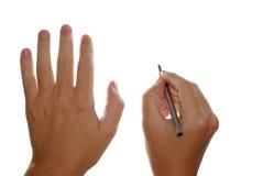 Mãos e pena de fonte imagens de stock royalty free
