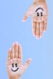 Mãos e sorriso Imagens de Stock