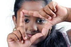 Mãos em uma forma do viewfinder fotos de stock