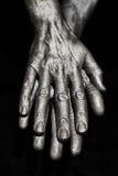 Mãos esculturais do homem do metal Foto de Stock