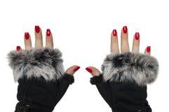 Mãos fêmeas com luvas do encanto fotografia de stock royalty free