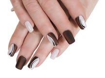 Mãos fêmeas com manicure Foto de Stock
