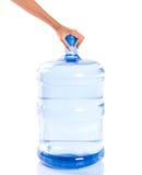 Mãos fêmeas com o grande recipiente IV da água mineral Fotografia de Stock Royalty Free
