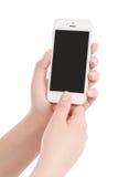 Mãos fêmeas que guardam o telefone esperto moderno branco e que pressionam o butto Imagens de Stock Royalty Free