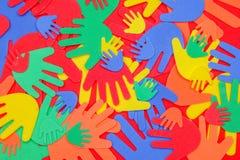 Mãos funky brilhantemente coloridas da espuma foto de stock