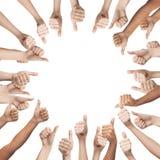 Mãos humanas que mostram os polegares acima no círculo Foto de Stock