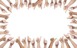 Mãos humanas que mostram os polegares acima no círculo Fotos de Stock