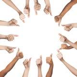 Mãos humanas que mostram os polegares acima no círculo Imagem de Stock Royalty Free