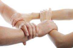 Mãos humanas que mostram a unidade Fotografia de Stock Royalty Free