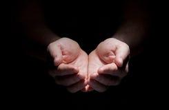Mãos isoladas no conceito preto fotografia de stock royalty free
