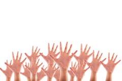 Mãos levantadas povos no fundo branco Fotos de Stock