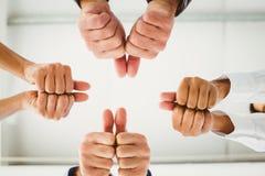 Mãos múltiplas que dão os polegares acima Fotografia de Stock Royalty Free