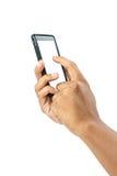 Mãos masculinas que tocam no smartphone móvel isolado com grampeamento Imagens de Stock Royalty Free