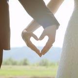 Mãos na forma do coração Foto de Stock