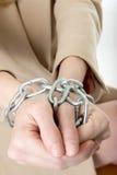 Mãos nas correntes Fotos de Stock Royalty Free