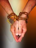 Mãos nas correntes Imagem de Stock