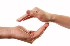 Mãos no gesto do cuidado Fotografia de Stock Royalty Free
