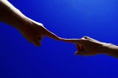 Mãos no toque Fotografia de Stock