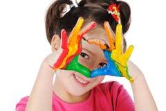 Mãos pintadas em pinturas coloridas Fotografia de Stock Royalty Free