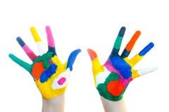 Mãos pintadas em pinturas coloridas imagem de stock