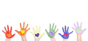 Mãos pintadas para uma beira Foto de Stock Royalty Free