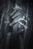 Mãos prateadas em um fundo preto fotos de stock royalty free