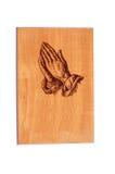 Mãos Praying na madeira foto de stock royalty free