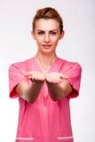 Mãos prolongadas de uma enfermeira Imagens de Stock Royalty Free
