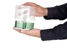 Mãos que abrem um recipiente do CD Fotos de Stock