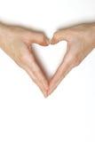 Mãos que dão forma ao coração Fotografia de Stock Royalty Free