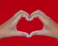 Mãos que dão forma a um coração Imagem de Stock
