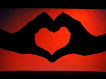 Mãos que dão forma a uma forma do coração Imagem de Stock Royalty Free
