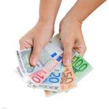 Mãos que dão o euro- dinheiro imagens de stock royalty free