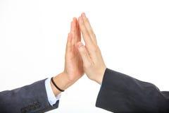 Mãos que dão uns cinco altos fotografia de stock royalty free