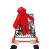 Mãos que empurram o carrinho de compras com o homem 3D vermelho Fotografia de Stock