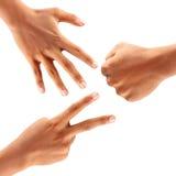 Mãos que fazem as tesouras de papel da rocha isoladas no fundo branco Foto de Stock