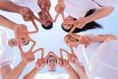 Mãos que formam a estrela Fotos de Stock Royalty Free