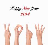 Mãos que formam o número 2014 Imagem de Stock