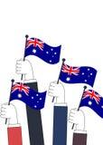 Mãos que guardam bandeiras australianas Imagem de Stock Royalty Free