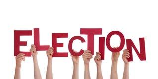 Mãos que guardam a eleição Fotografia de Stock Royalty Free