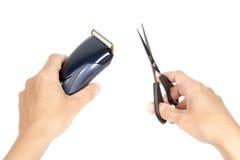 Mãos que guardam ferramentas do cabelo Fotografia de Stock