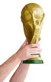 Mãos que guardam o campeonato do mundo do futebol Fotografia de Stock
