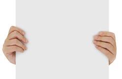 Mãos que guardam o papel vazio Fotos de Stock Royalty Free