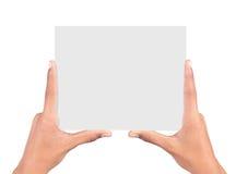 mãos que guardaram o cartão Imagens de Stock