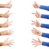 Mãos que mostram números imagens de stock