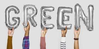 Mãos que mostram a palavra dos balões no isolado imagens de stock royalty free