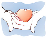 Mãos que prendem o coração Foto de Stock